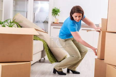 Photo for Middle-aged woman moving to new flat - Royalty Free Image