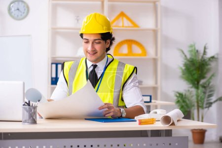 Photo for Male construction engineer working in the office - Royalty Free Image