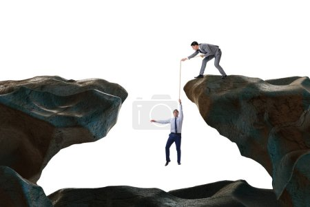 Photo pour Homme d'affaires aidant collègue avec la corde - image libre de droit