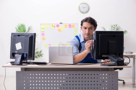 Photo for Male it specialist working in the office - Royalty Free Image