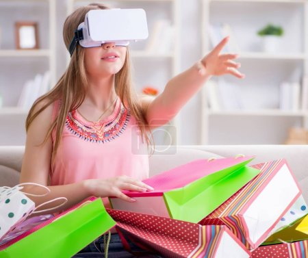 Photo for The young woman doing shopping with virtual reality glasses - Royalty Free Image