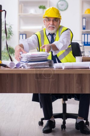 Photo for Old male architect working in office - Royalty Free Image