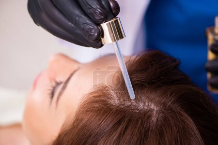 Photo for Young woman visiting beautician in hair transplantation concept - Royalty Free Image