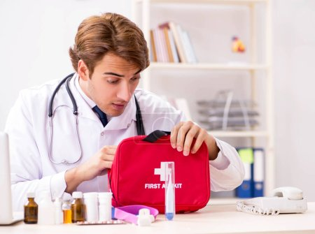 Photo for The young doctor with first aid kit in hospital - Royalty Free Image