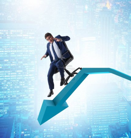 Photo for The businessman sliding down on chair in economic crisis concept - Royalty Free Image