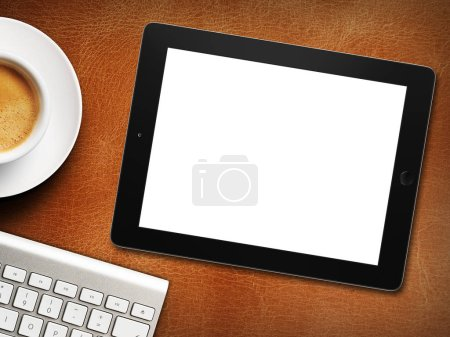 Photo for Tablet white screen similar to ipad display and coffee on background - Royalty Free Image