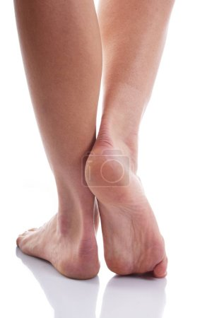 Photo for Close view of tired female feet isolated on white background - Royalty Free Image