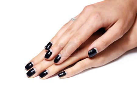 Girl's hand with black manicure nails...