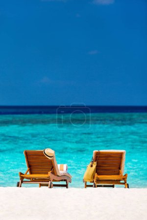 Photo for Wooden lounge chairs on a beautiful tropical beach at Maldives - Royalty Free Image
