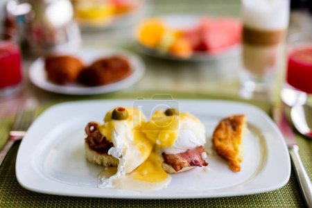 Photo for Delicious breakfast with eggs Benedict and coffee - Royalty Free Image