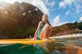 Young beautiful girl enjoying summer vacation on exotic island in Caribbean