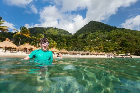 Teenage boy enjoying summer vacation on exotic island in Caribbean