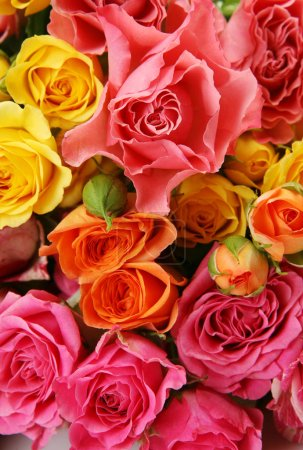 a bouquet of yellow and pink roses