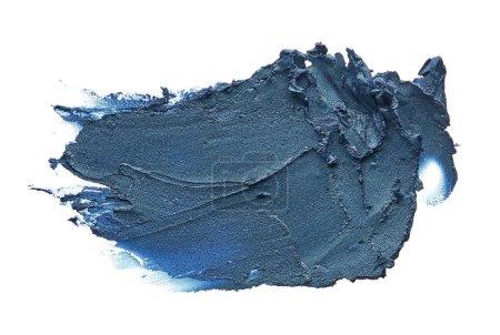 Navy blue creamy eye shadow isolated on white background. Texture of dark blue eye shadow on white. Smear of creamy eye shadow