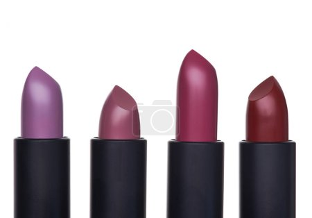 Photo for Exclusive and expensive lipsticks in a black tubes on a white background. Fashionable colors of the season - Royalty Free Image