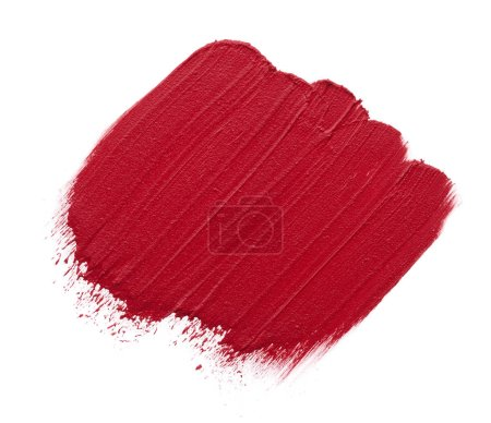 Red makeup smear of matte lip gloss isolated on white background. Red creamy lipstick texture isolated on white background