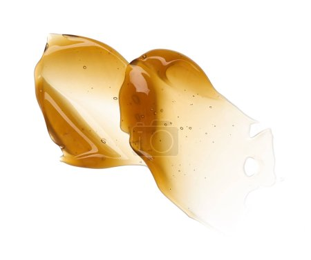 Transparent yellow smear of face cream or golden honey isolated on white background. Golden creamy honet texture on white background