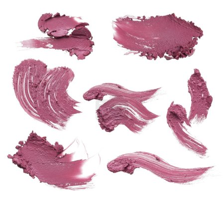 Smears of different colors are made by various cosmetic products isolated on a white background. Texture of multi-colored strokes of various make-up cosmetics on a white background