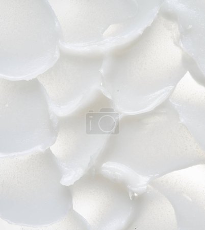 White smear of cosmetic cream isolated on white background. Creamy foundation texture isolated. Smear of face cream isolated. Texture of cream background