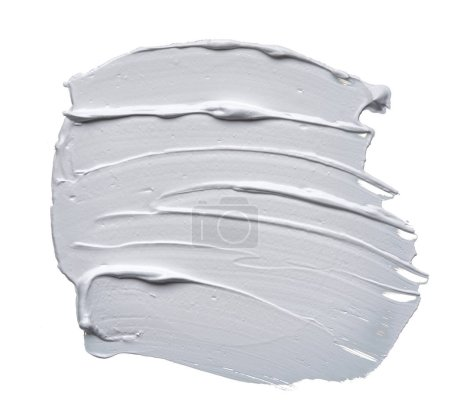 Stunning and exclusive smears and texture made with face clay on white background. White smear of cosmetic cream isolated on white background. White creamy acrylic paint texture