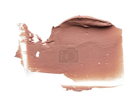 Light beige makeup smear of creamy foundation isolated on white background. Light beige creamy foundation texture background