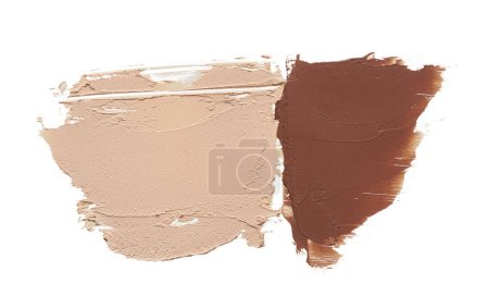 Light beige and brown makeup smears of creamy foundation isolated on white background