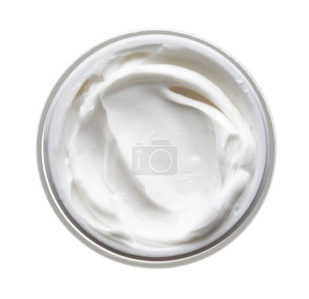 White beauty cream in a jar on a white background