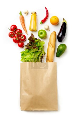 Photo pour Photo du sac en papier avec les légumes, les jus, les orange isolé sur fond blanc - image libre de droit