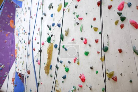Photo of climbing wall with safety ropes