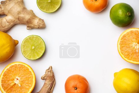 Photo for Image of ginger, lemon, oranges on white background with place for inscription - Royalty Free Image