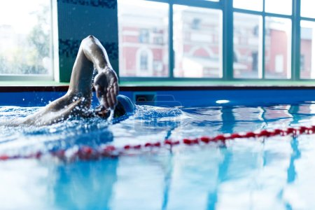 Photo for Photo of athlete man swimming in pool indoors on workout - Royalty Free Image