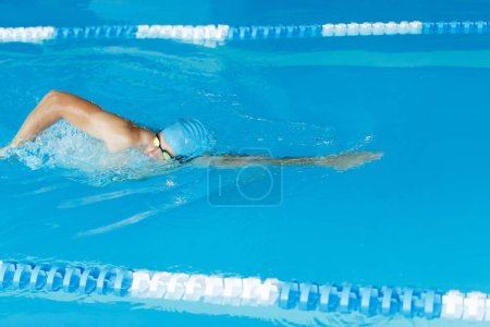 Freestyle swimmer in swimming pool