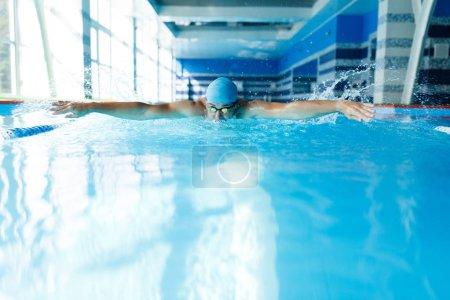 Photo for Photo of sportive man swimming in pool during workout - Royalty Free Image