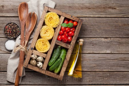 Photo for Pasta and ingredients. Tomatoes, basil, cucumbers and spices. Cooking concept. Top view with copy space - Royalty Free Image
