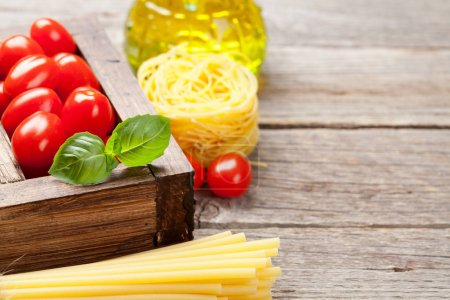 Photo for Pasta and ingredients. Tomatoes, basil, olive oil. Cooking concept. With space for your text - Royalty Free Image