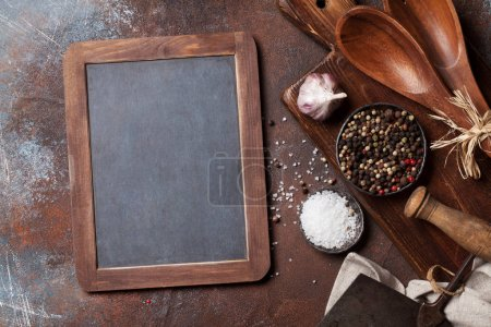 Vintage kitchen utensils and spices over cutting board. Cooking concept. Top view with space for your text
