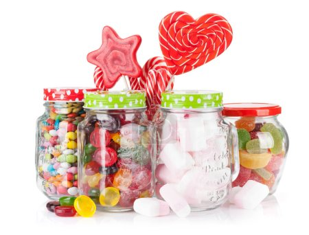 Colorful sweets. Lollipops, macaroons, marshmallow, marmalade and candies in jars isolated on white background