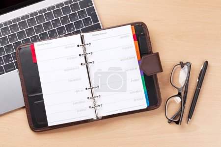 Photo for Office workplace table with notepad and laptop. Flat lay. Top view with space for your text - Royalty Free Image