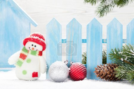 Photo for Christmas snowman toys, baubles and fir tree branch. Xmas decor - Royalty Free Image
