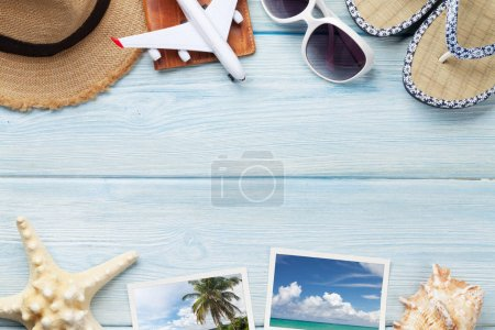 Photo for Travel vacation background concept with sunglasses, hat, passport, airplane toy and weekend photos on wooden backdrop. Top view with copy space. Flat lay. All photos taken by me - Royalty Free Image
