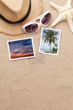 Photo for Travel vacation background concept with hat, sunglasses, seashells and photos on sand backdrop. Top view with copy space. Flat lay. All photos taken by me - Royalty Free Image
