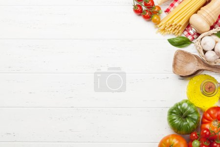 Photo for Pasta, tomatoes and herbs. Cooking ingredients on wooden table. Top view with copy space. Flat lay - Royalty Free Image