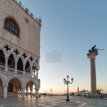 Outdoor cafe near Palace of doges on San Marco square at sunrise in Venice, Italy