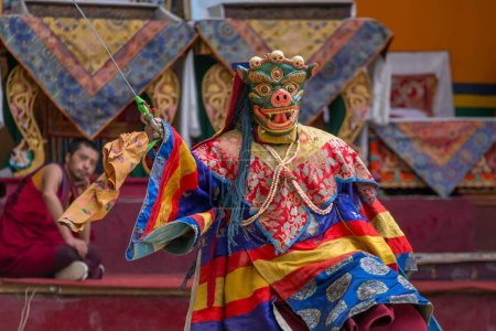 Lamayuru, India - June 21, 2017: Unidentified monk in mask perform religious masked and costumed mystery dance of Tibetan Buddhism Gompa, Ladakh.