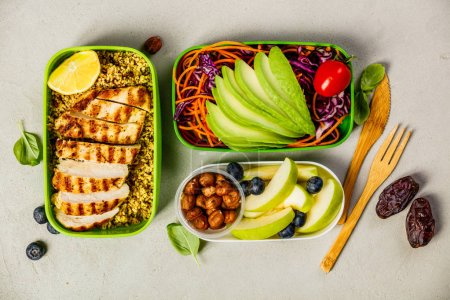 Photo for Healthy meal prep containers: Couscous with grilled chicken breast, salad, avocado, berry, apple, nuts and dry dates. Keto, ketogenic diet, low carb, healthy food concept. Top view - Royalty Free Image