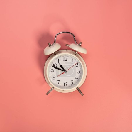 Photo for White alarm clock on pink background - Royalty Free Image