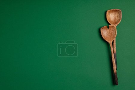Photo for Wooden serving spoons on colorful background, flat lay. Healthy eating or cooking concept - Royalty Free Image