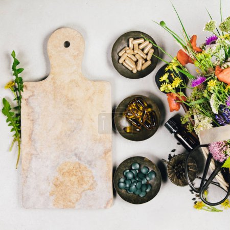 Photo for Flat lay of wild healing herbs and flowers. Clean eating, paleo, biohacking, herbal medicine concept - Royalty Free Image