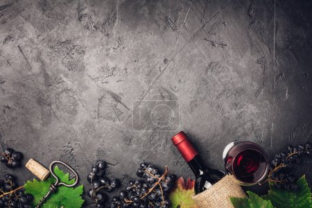 Photo for Wine with grapes, leaves and corks on dark background, copyspace, flat lay - Royalty Free Image