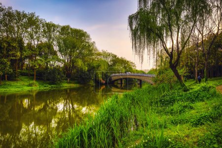 Photo for Old traditional Chinese bridge in city park. - Royalty Free Image